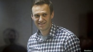 FILE PHOTO: Russian opposition politician Alexei Navalny attends a court hearing in Moscow, Russia February 20, 2021. REUTERS…