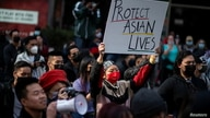 People take part in a Stop Asian Hate rally at Times Square in New York City, U.S., April 4, 2021.  REUTERS/Eduardo Munoz