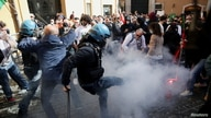 Restaurant owners clash with police as tensions rise over COVID-19 restrictions on businesses, in Rome, Italy April 6, 2021…