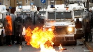 A fire burns in front of the police on the Springfield Road as protests continue in Belfast, Northern Ireland April 8, 2021…