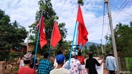 Demonstrators carry flags as they protest against the military coup in a village in Launglon township, Myanmar April 9, 2021…