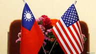 FILE PHOTO: Flags of Taiwan and U.S. are placed for a meeting between U.S. House Foreign Affairs Committee Chairman Ed Royce…