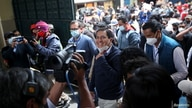 Ecuador's presidential candidate Andres Arauz smiles as he arrives with his running mate Carlos Rabascall at a polling station…