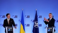 NATO Secretary General Jens Stoltenberg and Ukrainian Foreign Minister Dmytro Kuleba give a press conference in Brussels,…
