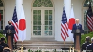 Japan's Prime Minister Yoshihide Suga and U.S. President Joe Biden hold a joint news conference in the Rose Garden at the White…