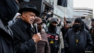 Rev. Jesse Jackson addresses demonstrators during a march through downtown after the closing statements in the trial of former police officer Derek Chauvin, who is facing murder charges in the death of George Floyd, in Minneapolis, April 19, 2021.