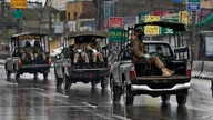 Pakistan Army troops patrol after a government announced to lockdown the city for concerns over the spread of the new…