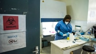 In this photo taken Friday, June 19, 2020, a laboratory specialist secures samples taken from potential coronavirus patients at…