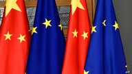 FILE - In this file photo dated Tuesday, Dec. 17, 2019,  EU and Chinese flags at the Europa building in Brussels. China's…