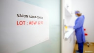 A door sign shows the batch of AstraZeneca vaccine currently used at a vaccination center in Bucharest, Romania, April 7, 2021.