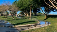 Sprinklers water grass at a park on Friday, April 9, 2021, in the Summerlin neighborhood of Las Vegas. A desert city built on a…