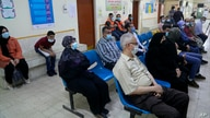People wait to receive a coronavirus vaccine at a clinic in Baghdad, Iraq, Sunday, April 11, 2021. The health ministry has…
