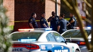 Knoxville police work the scene following a shooting at Austin-East Magnet High School in Knoxville, Tenn., Monday, April 12,…