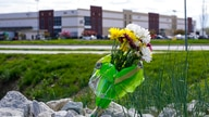 A single bouquet of flower sits in the rocks across the street from the FedEx facility in Indianapolis, Saturday, April 17,…