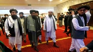 FLE - Taliban co-founder Mullah Abdul Ghani Baradar, center, arrives with other members of Taliban delegation.