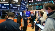 In this photo provided by the New York Stock Exchange, traders work on the floor, Wednesday April 21, 2021. Stocks were mostly…