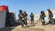 An image obtained from the media office of the Kurdish People's Protection Units in Syria (YPG) March 29, 2021 shows YPG forces conducting a security operation the previous day at the Kurdish-run al-Hol camp. (AFP PHOTO/HO/YPG)
