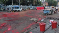 "This photo taken by and received from an anonymous source via Facebook April 10, 2021, shows red paint splattered on the ground amid flyers promoting a student-led ""Red Movement"" in protest against the military coup in Yangon."