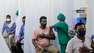 People are administered COVID-19 vaccine in Mumbai, India, April 13, 2021.
