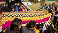 FILE - Relatives carry a casket with the body of journalist Malala Maiwand, who was shot and killed by gunmen, during her funeral in Jalalabad, east of Kabul, Afghanistan, Dec. 10, 2020.