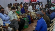 People wait to receive a COVID-19 vaccine at a vaccination site in Mumbai, India, April 18, 2021.