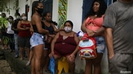 Members of the community Quilombo Quilomba, descendants of African slaves, wait to receive shots of Sinovac's CoronaVac vaccine, in Mage, Rio de Janeiro state, Brazil, April 7, 2021.
