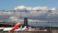FILE - Airplanes are seen parked on the tarmac at Adolfo Suarez Barajas Airport in Madrid, Spain, Dec. 15, 2020.