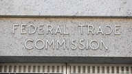 FILE - Signage is seen at the Federal Trade Commission headquarters in Washington, D.C., Aug. 29, 2020.