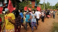This handout photo taken and released by Dawei Watch on May 5, 2021 shows protesters holding signs during a demonstration…