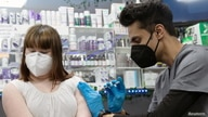 Lauren Borenstein, 16, who has Down Syndrome, receives the Pfizer-BioNTech vaccine against the coronavirus disease (COVID-19)…