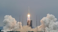 FILE PHOTO: The Long March-5B Y2 rocket, carrying the core module of China's space station Tianhe, takes off from Wenchang…