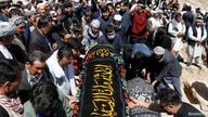 Afghan men prepare victims' coffins for a mass funeral ceremony after yesterday's explosion in Kabul, Afghanistan May 9, 2021…