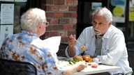 FILE PHOTO: People eat at the King's Head pub as Los Angeles County moves into the least restrictive yellow coronavirus disease…
