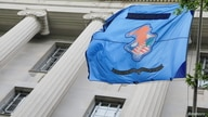 The flag and crest of the United States Department of Justice (DOJ) is seen at their headquarters in Washington, D.C., U.S.,…