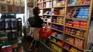 FILE PHOTO: Paula Jarvis, 61, buys biscuits at the King's Head pub as Los Angeles County moves into the least restrictive…