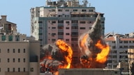 The al-Jalaa building housing Associated Press (AP) and Al Jazeera media offices is hit by an Israeli air strike in Gaza City, May 15, 2021.
