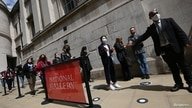 Visitors queue to enter The National Gallery as coronavirus disease (COVID-19) restrictions continue to ease in London, Britain…