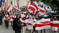 Activists march during a rally in support of Belarusian anti-government movement and detained blogger Roman Protasevich, in…
