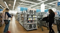 FILE - In this March 25, 2021 file photo, shoppers look at items in Bed, Bath and Beyond, in New York. U.S. consumer prices…