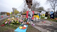 A makeshift memorial is seen at the site where Daunte Wright was killed a day after he was laid to rest, April 23, 2021, in Brooklyn Center, Minn. The 20-year-old Wright was killed by then-Brooklyn Center police officer Kim Potter during a traffic stop.
