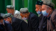 Uyghurs and other members of the faithful pray during services at the Id Kah Mosque in Kashgar in western China's Xinjiang…