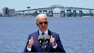 President Joe Biden speaks with the Interstate 10 Calcasieu River Bridge behind him, Thursday, May 6, 2021, in Lake Charles, La…