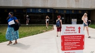 FILE - Students exit the KSU Ice Arena after getting their Johnson & Johnson COVID-19 vaccine.