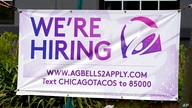A hiring sign is displayed outside of a restaurant during the COVID-19 pandemic in Glenview, Ill., Saturday, May 8, 2021. US…