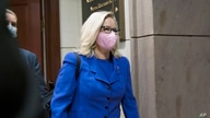 Rep. Liz Cheney, R-Wyo., arrives as House GOP members meet to decide whether she should be removed from her leadership role.