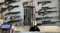 Firearms are displayed at a gun shop in Salem, Ore, Feb. 19, 2021.