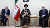 FILE - A handout picture provided by the office of Iran's Supreme Leader Ayatollah Ali Khamenei July 15, 2018, shows Khamenei (C) sitting between President Hassan Rouhani (R) and Foreign Minister Mohammad Javad Zarif (L) during a meeting in Tehran.