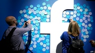 FILE - People stick notes on a Facebook logo at a Facebook developer conference, in San Jose, California, April 30, 2019. Facebook today lost a legal battle with Ireland that might force the social network to stop transferring data to the U.S.