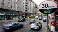 "FILE - Cars pass by a speed limit sign displaying a ""Thank you,"" on a street in Berlin, Germany, May 20, 2019."