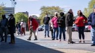 FILE - Job seekers queue outside an employment center in Louisville, Kentucky, April 15, 2021.